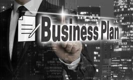 Affärsplanet visas av affärsmanbegrepp arkivbild