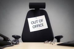 Affärsstol med ut ur kontorstecknet Fotografering för Bildbyråer