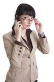 affärscell över talande kvinna för telefon Arkivbild