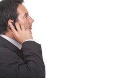 affärsmanfelanmälansmobiltelefon hans framställning royaltyfri fotografi