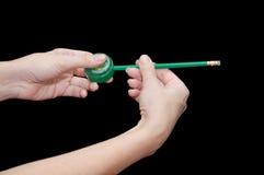 Affûteuse et crayon verts Image stock