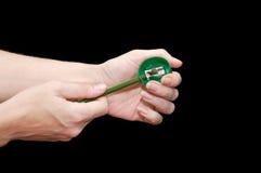 Affûteuse et crayon verts Images libres de droits