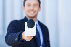 Affable newsman is listening to the interviewed Stock Photography