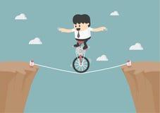 Affaires équilibrant sur la corde Photo libre de droits