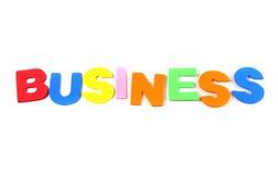 Affaires dans les lettres colorées de jouet Images libres de droits