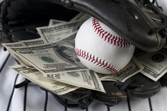 Affaires de base-ball et d'argent Photo stock