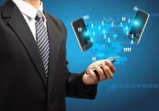 Affaires de technologie de téléphones portables à disposition Photographie stock