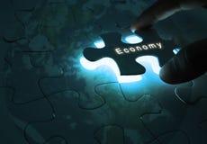Affaires globales d'économie avec le puzzle images stock