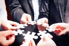 Affaires Team With Jigsaw Puzzle Photos libres de droits