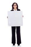 Affaires womanholding un panneau blanc blanc image stock