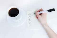 Affairs list and cup of Coffe. Making a list of important cases Royalty Free Stock Photography