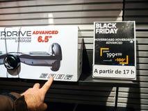 Affare d'equilibratura dell'uomo di Hoverdrive del motorino di auto della catena di negozi di Fnac Fotografia Stock Libera da Diritti
