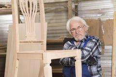 Affare fatto a mano alla piccola fabbrica della mobilia Immagine Stock