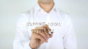 Affare locale di sostegno, scrittura dell'uomo sul vetro Fotografie Stock Libere da Diritti