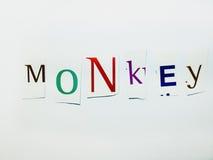 Affe - Ausschnitt fasst Collage von Mischzeitschriften-Buchstaben mit weißem Hintergrund ab Lizenzfreies Stockbild