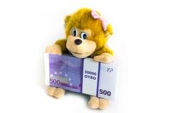 Affe, der Dollar hält Stockfoto