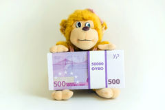 Affe, der Euro hält Lizenzfreies Stockfoto