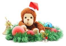 Affe in einem Weihnachtshut Stockfoto