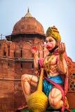 Affe-hindischer Gott Hanuman vor rotem Fort - Neu-Delhi, Indien Lizenzfreie Stockfotos