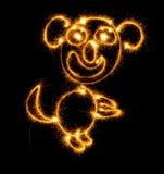 Affe machte Wunderkerzen auf Schwarzem Lizenzfreie Stockbilder