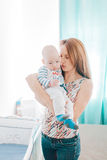 Affection of a mother Stock Photography