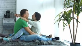 Loving couple enjoying free time in domestic room stock video footage