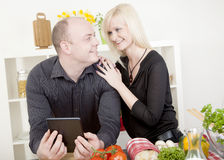 Affectionate couple preparing a meal Royalty Free Stock Photos