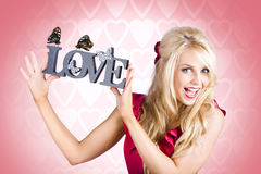 Affectionate blonde woman with love butterflies Royalty Free Stock Photos