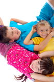 Affectionate children. In colorful clothes, relaxing together stock images