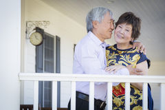 Affectionate Chinese Couple Enjoying Their House Royalty Free Stock Image