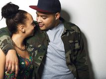 Affectionate cool young couple on grey background Royalty Free Stock Photo