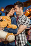 Affectionate couple at amusement park Royalty Free Stock Image