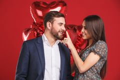 Affectionate couple with balloons. Flirting couple stock photos