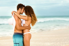 Affectionate couple on beach Royalty Free Stock Image