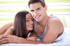 Affectionate couple in bed Royalty Free Stock Images