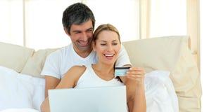 Affectionate couple buying on internet Royalty Free Stock Image