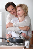 Affectionate couple cooking Royalty Free Stock Photography