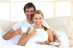 Affectionate couple drinking coffee Royalty Free Stock Image