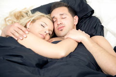 Affectionate couple enjoying a blissful sleep Stock Photos