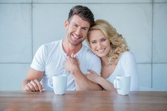 Affectionate couple enjoying a morning coffee Royalty Free Stock Photography
