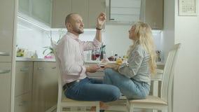 Loving couple enjoying romantic dinner in kitchen stock video footage
