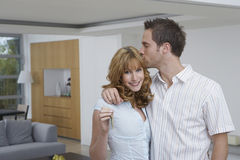 Affectionate Couple With Key In New Home Royalty Free Stock Image