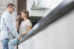 Affectionate couple in kitchen Stock Photography