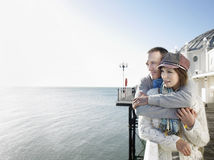 Affectionate Couple Looking Out At Sea On Pier Royalty Free Stock Photo