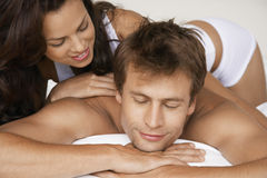Affectionate Couple Lying In Bed Stock Photo