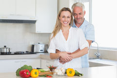 Affectionate couple preparing a healthy dinner together Stock Photo
