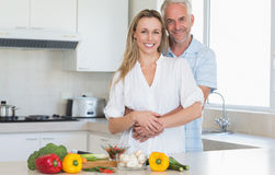 Affectionate couple preparing a vegetarian dinner together Stock Image