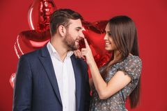 Affectionate couple with red balloons royalty free stock images