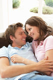 Affectionate Couple Relaxing At Home Together Royalty Free Stock Photos