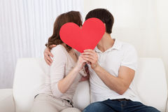 Affectionate couple relaxing on a sofa Royalty Free Stock Image